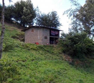 Quién diría que en esta casa de campesinos funciona un pequeño banco comunal